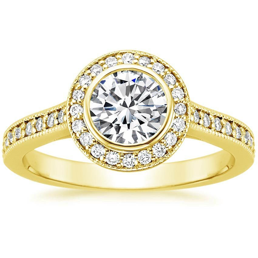 ROUND BEZEL HALO DIAMOND RING WITH SIDE STONES (1/3 CT. TW.)